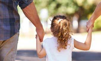 Young Girl Holding Her Parents Hands