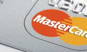 How does MasterCard make money?