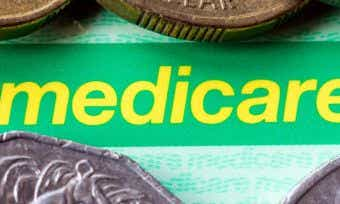 what is the difference between medicare and private health insurance