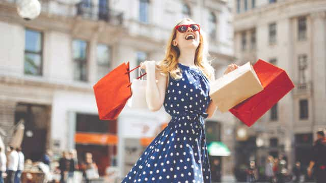 woman celebrating purchases