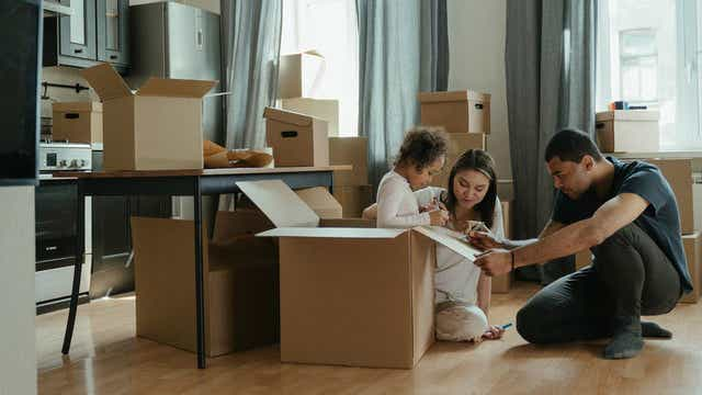 First home buyers unpacking after moving house.