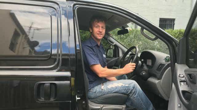 andy corcoran sitting in his van