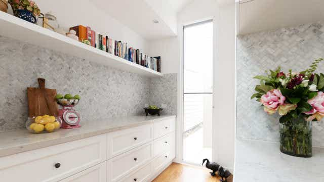 A semi-recessed butler's pantry
