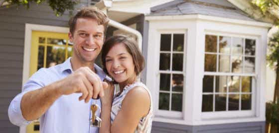 couple after buying their first home