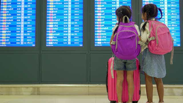 children travel insurance at airport