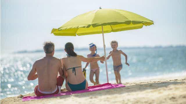 children travel insurance beach umbrella