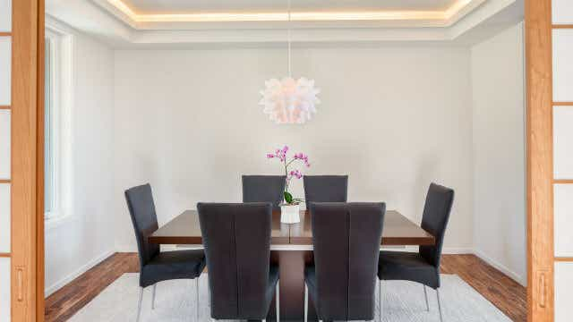 A pendant light over a dining table.