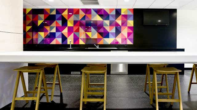 Colourful splashback in a kitchen.