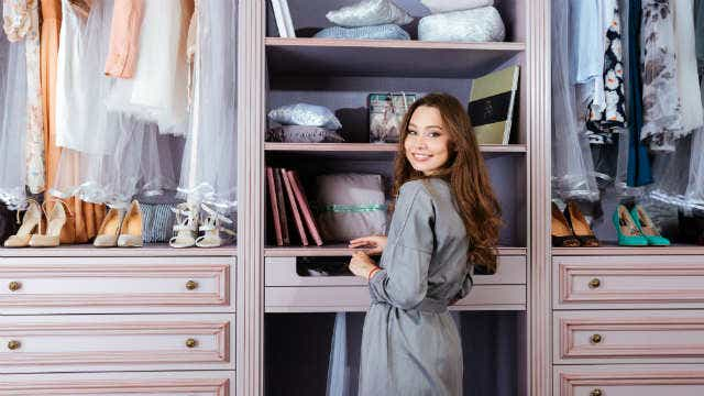 Image of a woman in front of her closet. News crop.