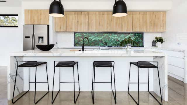 Large luxury Australian kitchen with marble island bench - Image
