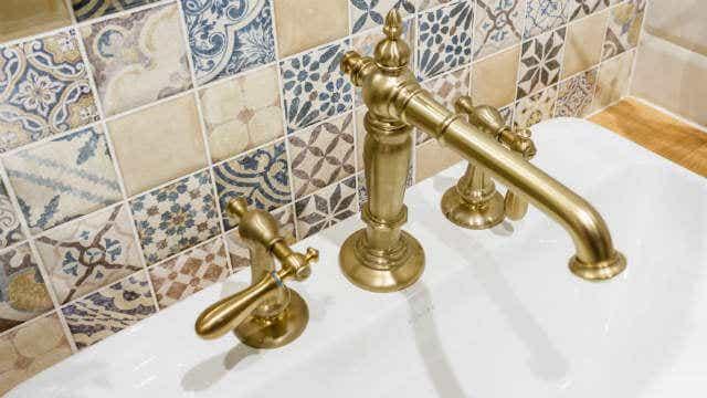Brushed gold tapware.