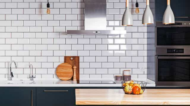 Modern interior. Spacious kitchen with white brick tile wall. - Image