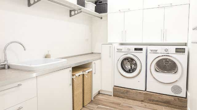 An image of a laundry room with a washer and dryer.