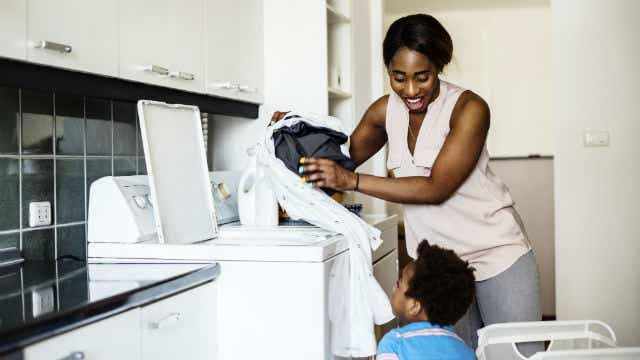 A woman and child sorting laundry.