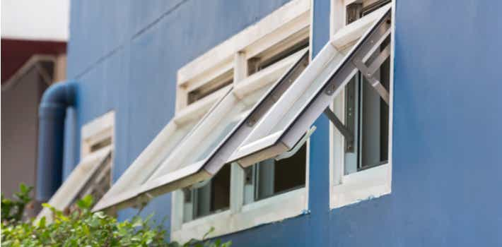 Open Awning windows in a blue wall