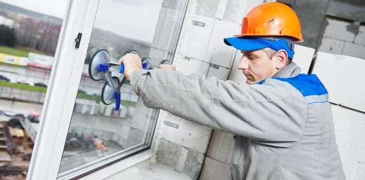 Builder installing window pane
