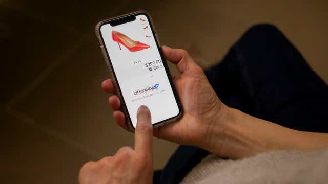 A shopper using the Afterpay app. Image: Ross Tomei (Shutterstock)