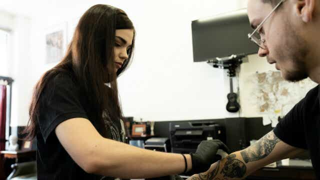 allegra maeva wiping down fresh tattoo