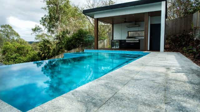 Swimming pool with entertaining and BBQ area adjacent