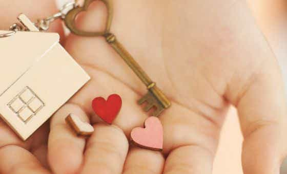 A picture of a pair of hands holding a house key with three hearts   Canstar