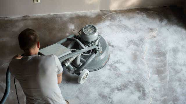 mechanically grinding concrete
