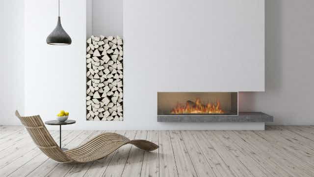 A picture of a fireplace in a modern living room.