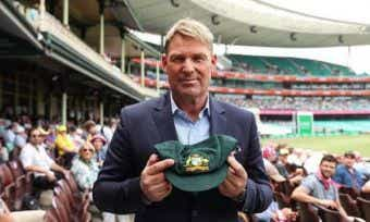 Bushfire relief auctions: Warnie's baggy green sold to CommBank for $1 million