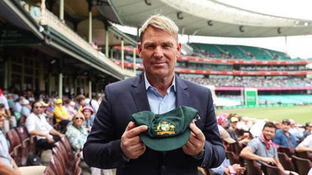 Shane Warne auctions baggy green for bushfires