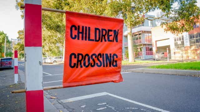 Sign on school crossing during peak school zone times