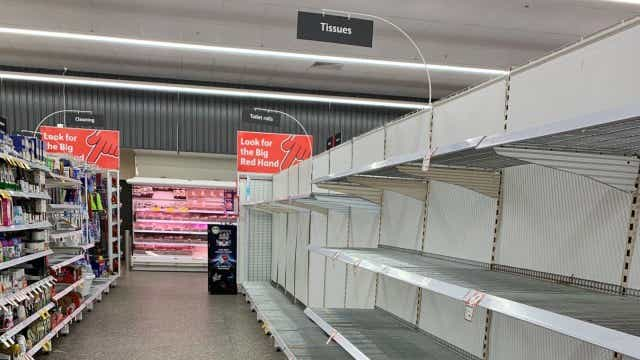 Toilet rolls and tissues have been stockpiled, leaving bare aisles in Coles and Woolworths.