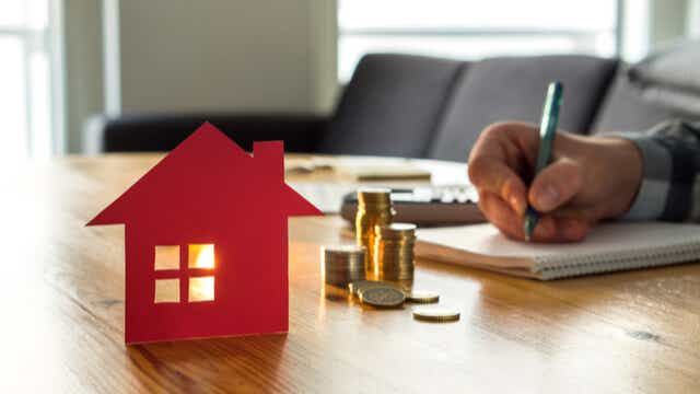 man doing tax after home sale