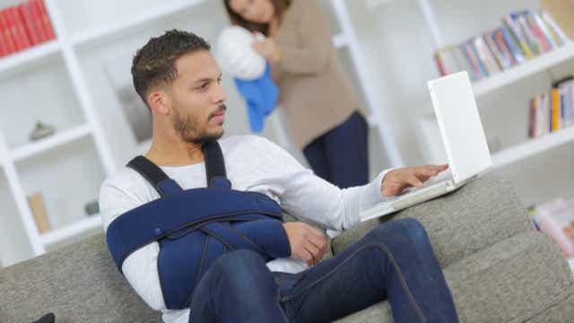 Injured man with laptop