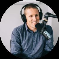 Male John Pidgeon is speaking into a radio microphone