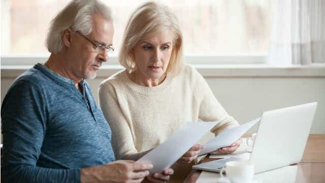 Older Couple looking at super
