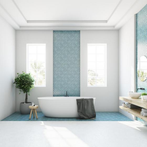 A renovated bathroom with aqua tile insert