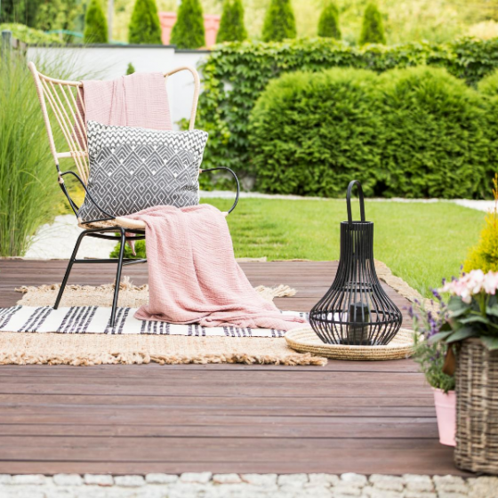 A deck dressed with a comfy chair