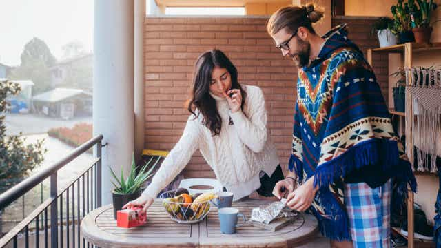 Young couple have breakfast at home