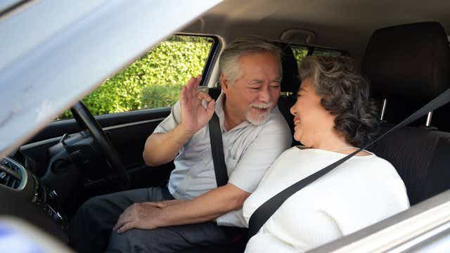 Mature couple driving