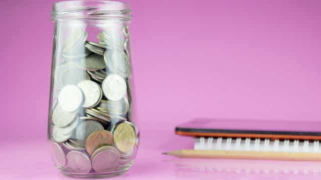 Savings shown with money change in jar