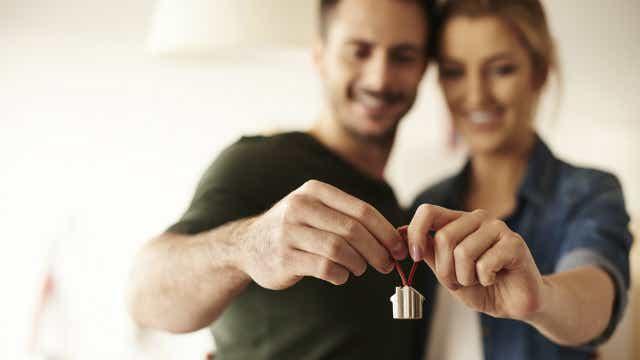 Couple holding house keyring