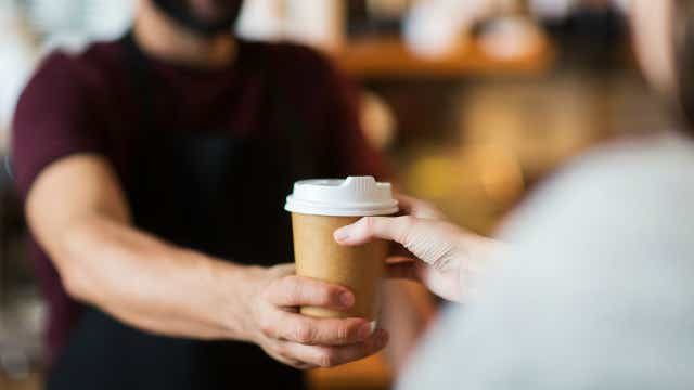 Person being given coffee