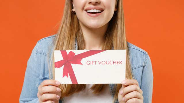 Woman with gift voucher