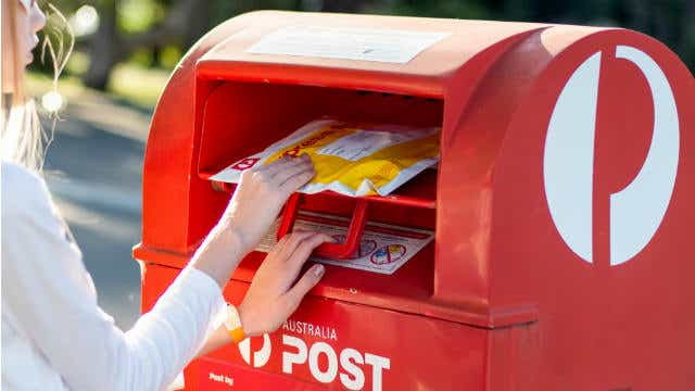 A person posts mail using Australia Post