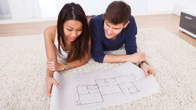 Couple looks at house plans