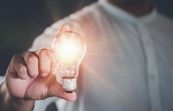 Man holding glowing lightbulb