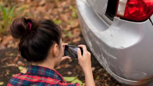 taking photo of damaged car