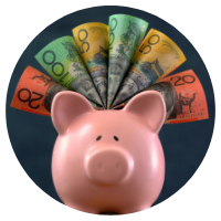 Australian bank notes sticking out of piggy bank